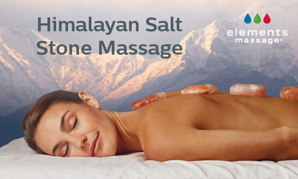 woman with salt stones on back during massage
