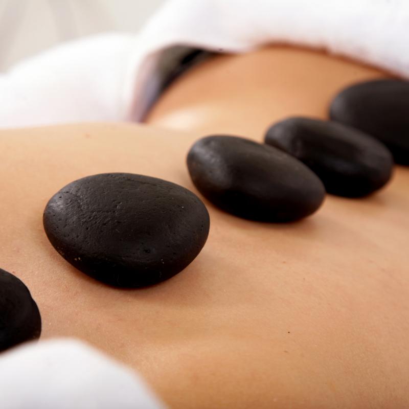 What is Hot Stone Massage? - Elements Massage - Eden Prairie