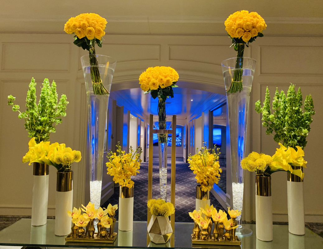 Beautiful display of vases with yellow flowers