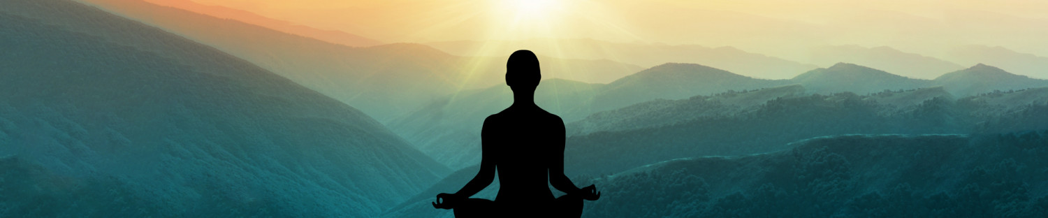 mountain with sunset and cutout of woman meditating