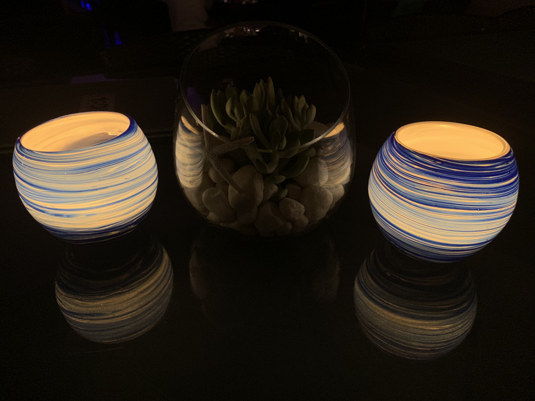 candlelight in round glass candle holders