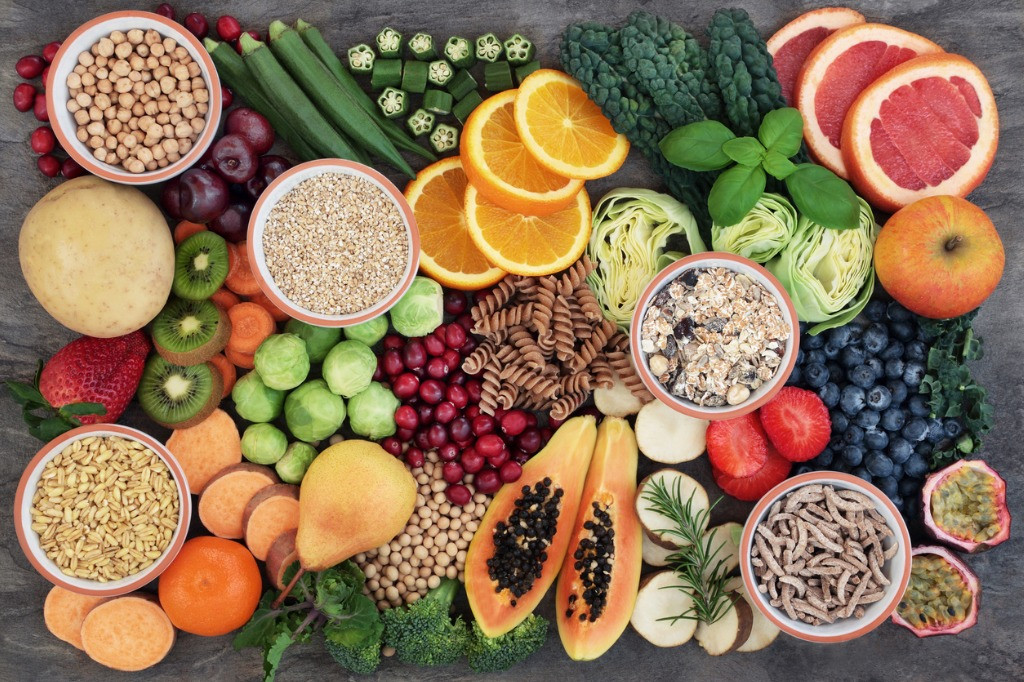 plate of fruits, vegetables, nuts and other healthy food