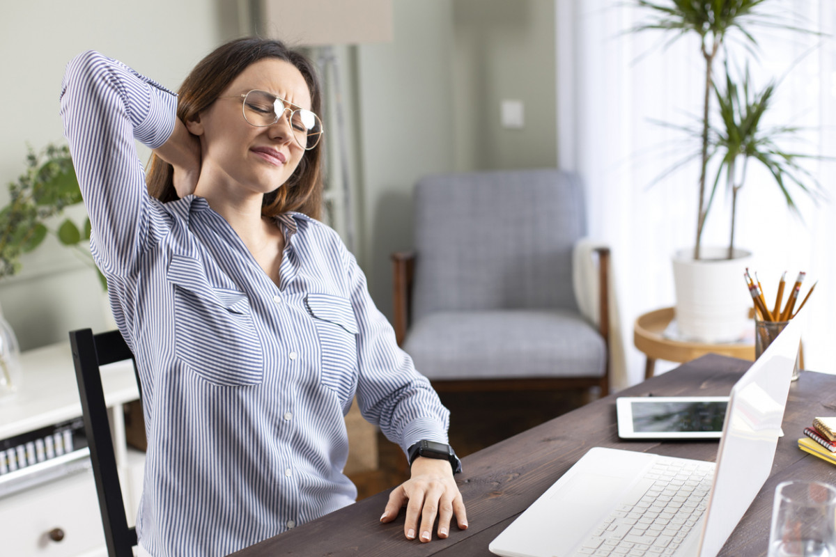 woman stretching at computer