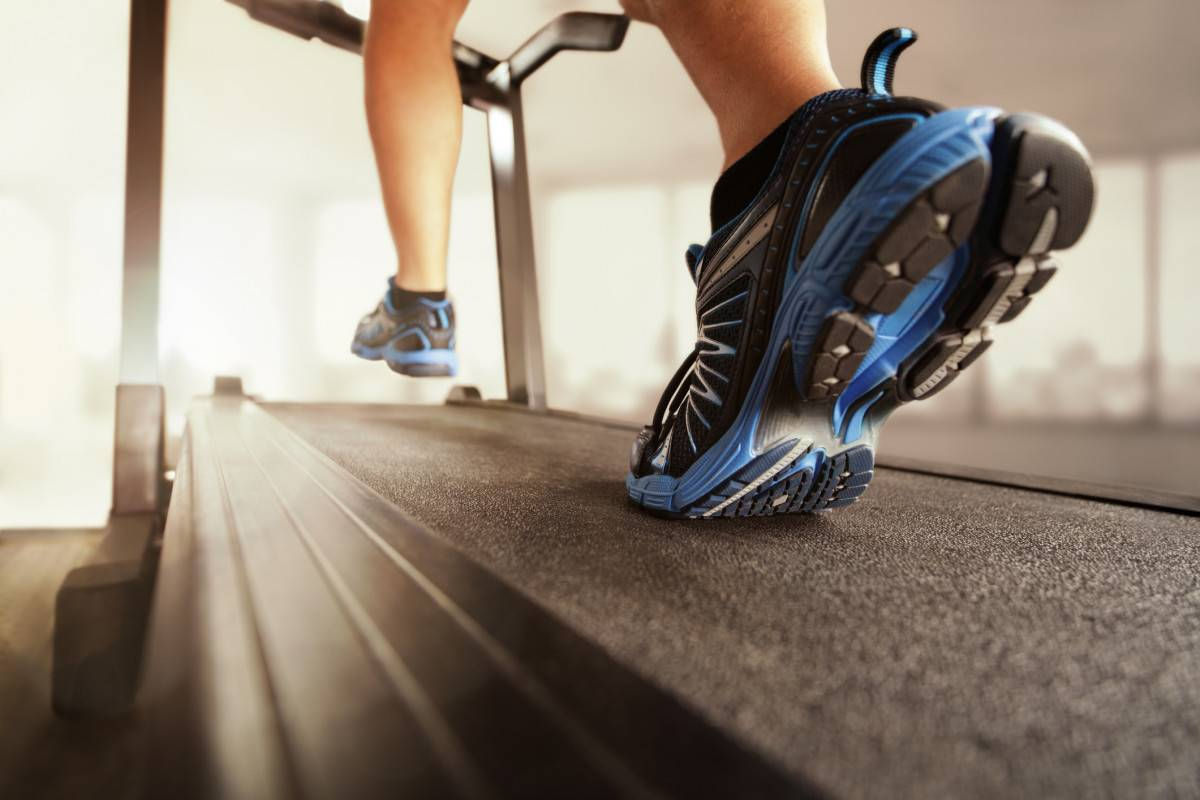 close-up of person's feet running on treadmill